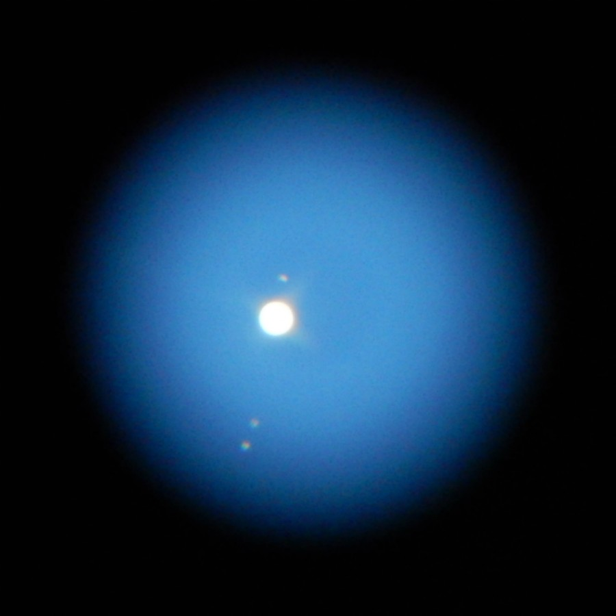 Jupiter and its moons shine triumphantly in the light of an April moon.