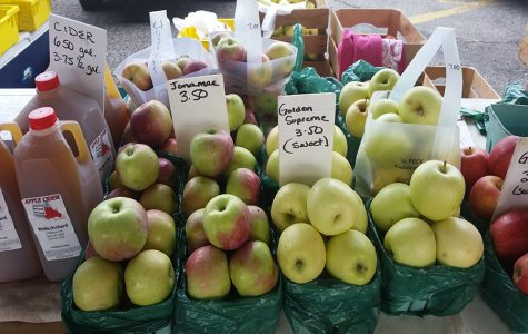The Wolfe Orchard stand at the Ann Arbor Farmers Market has many varieties of apples.