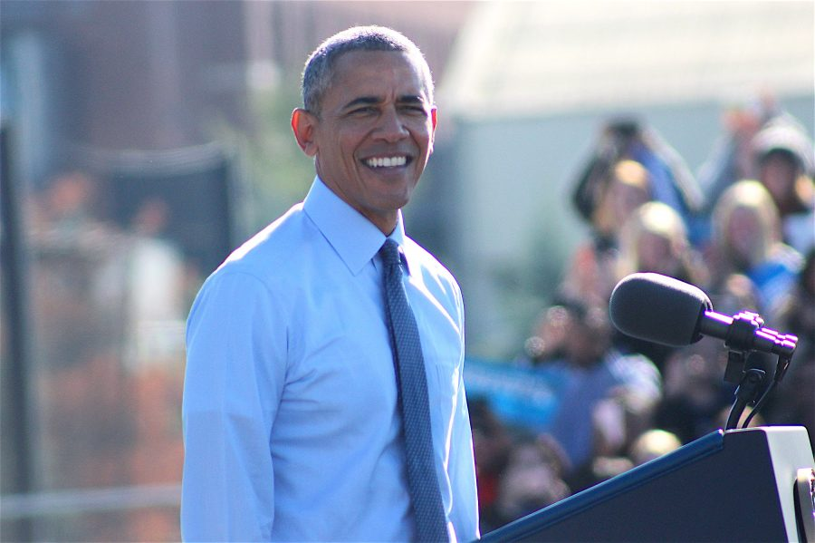 President Barack Obama stands before starting his speech as the crowd cheers.