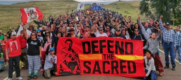 Protesters marching to a sacred burial site that was disturbed by bulldozers constructing the Dakota Access Pipeline.