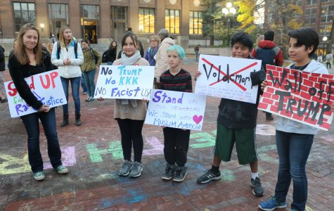 Kids pose with their signs.
