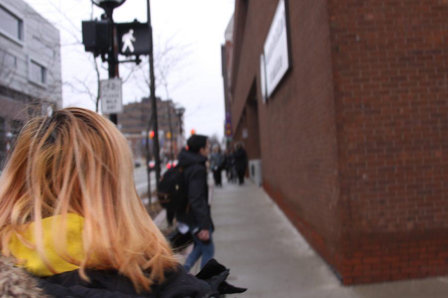 Elina Kang walks to Blake Transit Center in hopes of catching the 24 route bus, or the Washtenaw Community College bus to get to Pioneer.