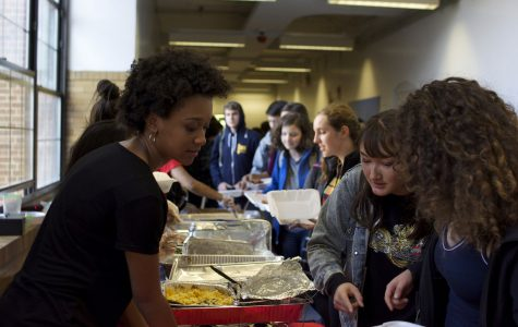 Hevin White, a BSU member, serves hungry students during Soul Food Friday.