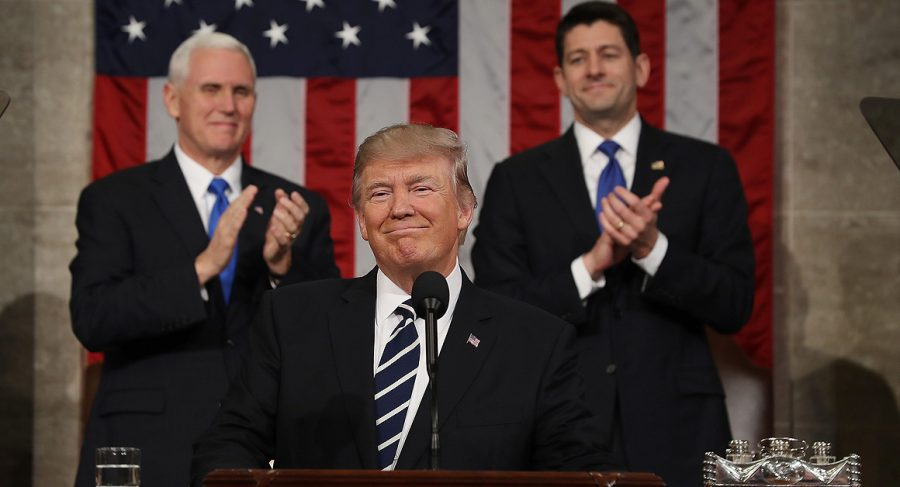 US Vice President Mike Pence (L) and Speaker of the House Paul Ryan (R) applaud US President Donald J. Trump. This was Trump's first address to a joint session of Congress. Trump concluded his speech by saying