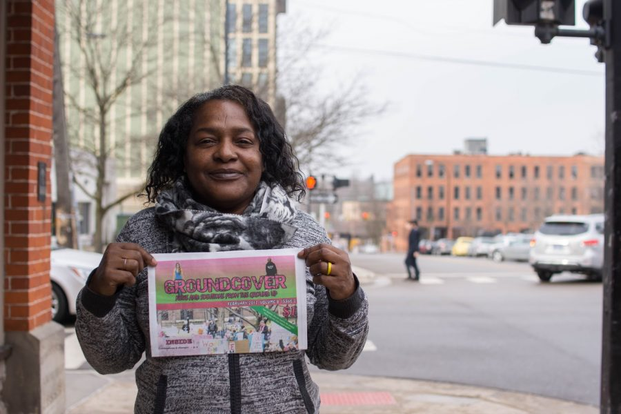 Felicia Wilbert shows the latest edition of Groundcover News. She has been selling since 2015. She doesn't know what she would do without Groundcover.