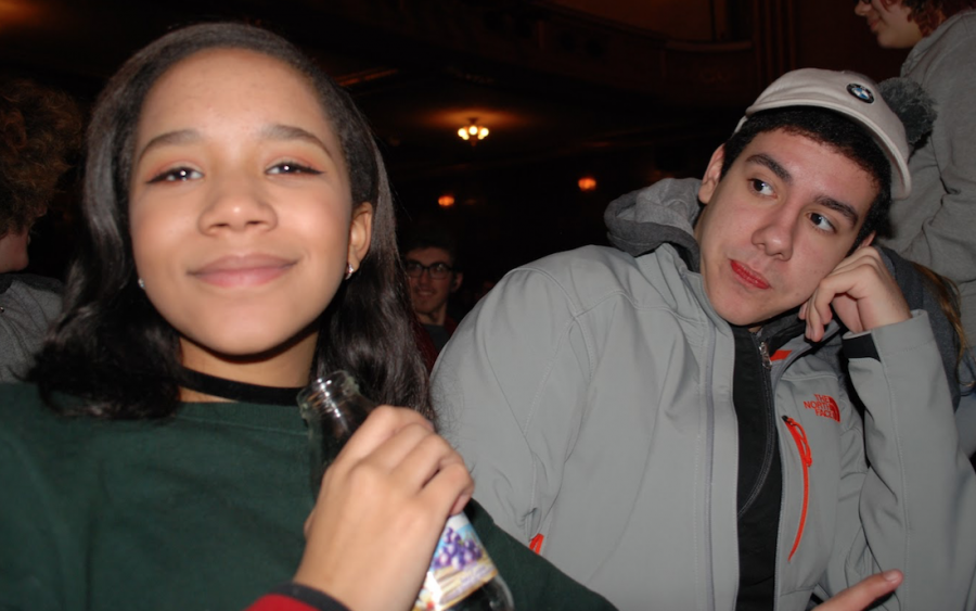 """Freshmen Maddie Wallace and Filipe Teixeira wait for the show to begin. Both students are part of the Coron forum, and they enjoyed the movie """"Selma"""" immensely. Teixeira said that the show made him feel close to tears, and Wallace was most moved by the scene of brutal beatings on the Edmund Pettus Bridge."""