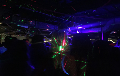 "February 11th, high school students are ""getting LOW"" at the B-Side, flashing lights and people blur together in the whirling action of the event."