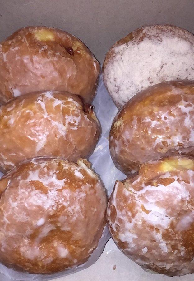 Pączki from Big City Small World Bakery via a special order. Left side are raspberry pączki, top right is an apple pączki, middle right is a custard pączki and bottom right is a chocolate pączki.