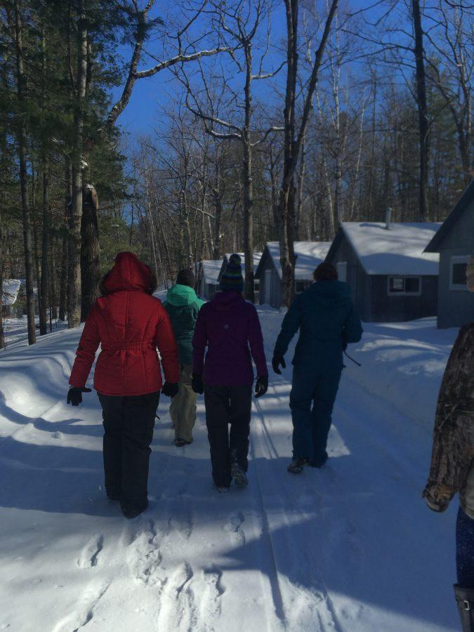 The ecology club is guided by Courtney Kiley on a tour around the campus of the University of Michigan Biological Station.