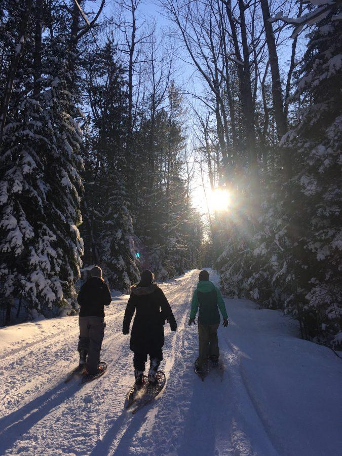 From left to right: Community High School teachers Marcy McCormick, Liz Stern and Courtney Kiley as they lead the ecology club on Hogsback Road on the way back from a hike around the gorge.
