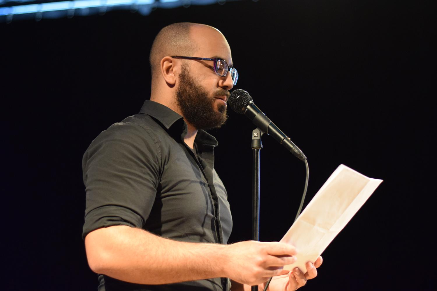Marlin Jenkins reads his poem to the silent crowd. Before he began reading, he addressed the crowd, creating a personal, undaunting environment. You with us? he asked the crowd towards the end of the reading. They responded positively. Beautiful.
