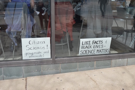 At the end of the march, those who remained, crowded into local restaurants around Ann Arbor, putting their hand-made signs in the windows.