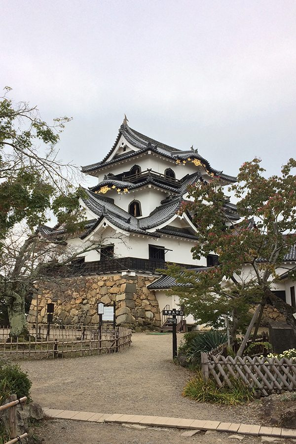The three story Hikone Castle in its original hill-side location.