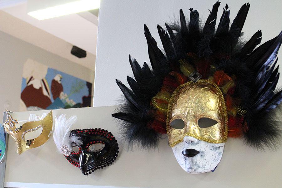 Venetian masks created by students in Italian art and culture.