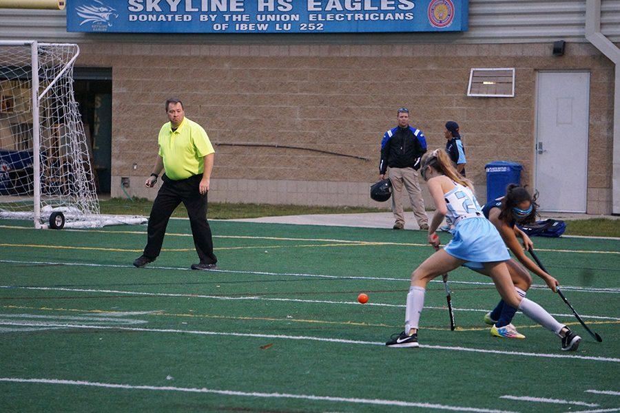 Freshman Madi Masek makes a move around a Cranbrook player as she heads towards the goal.