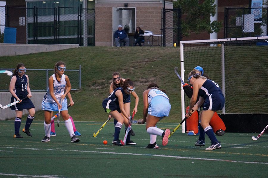 Danielle Davis passes the ball to Captain Sydney Vigo in the circle as Skyline attempts to score their third goal of the game.