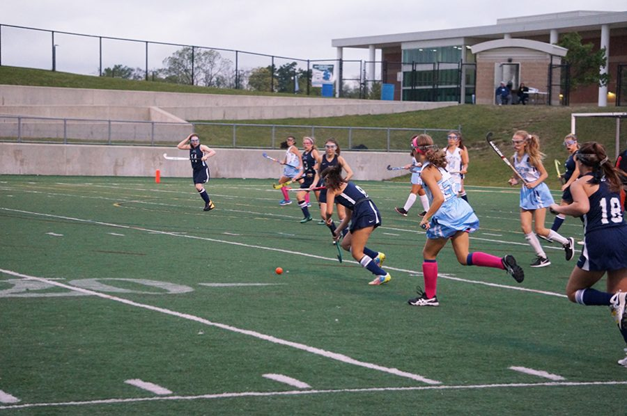 Skyline players rush back to play defense as Cranbrook gains possession of the ball.