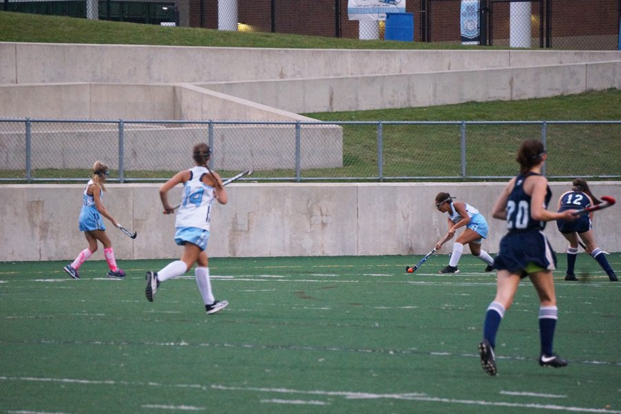 Danielle Davis passes the ball to open teammates as Cranbrook attempts to block a pass into the circle.