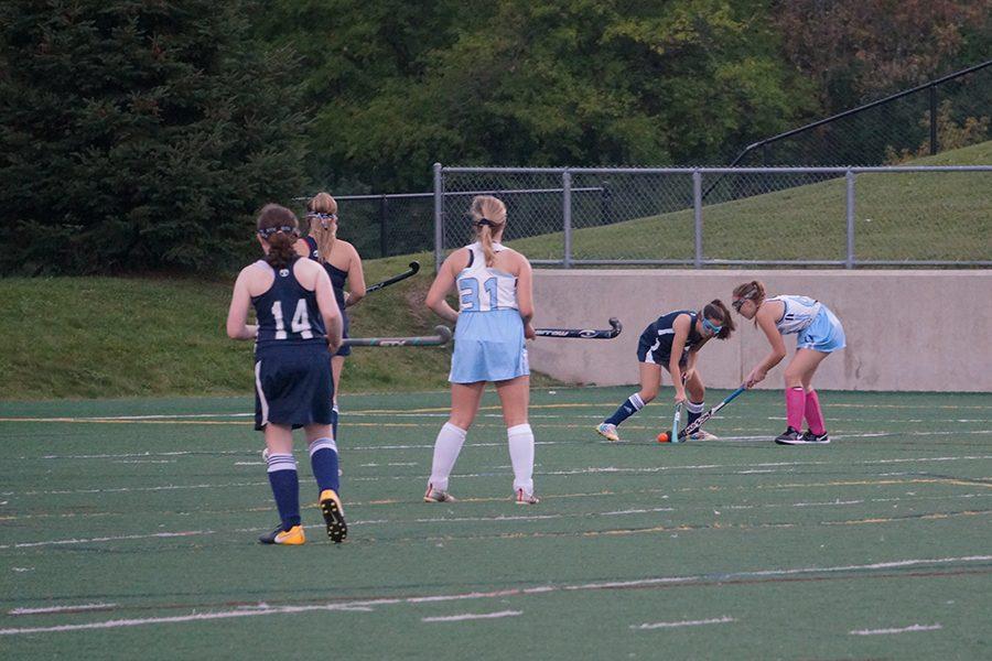 Skyline Sophomore Elena Schroeder makes a tackle against a Cranbrook player.