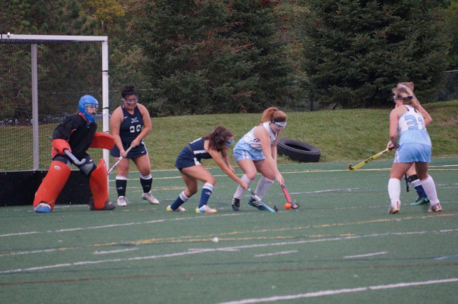 Skyline Junior Julia Barge lines up to shoot on Cranbrook's goalie. Junior Gabrielle Willacker stands a few feet away as a pass option.