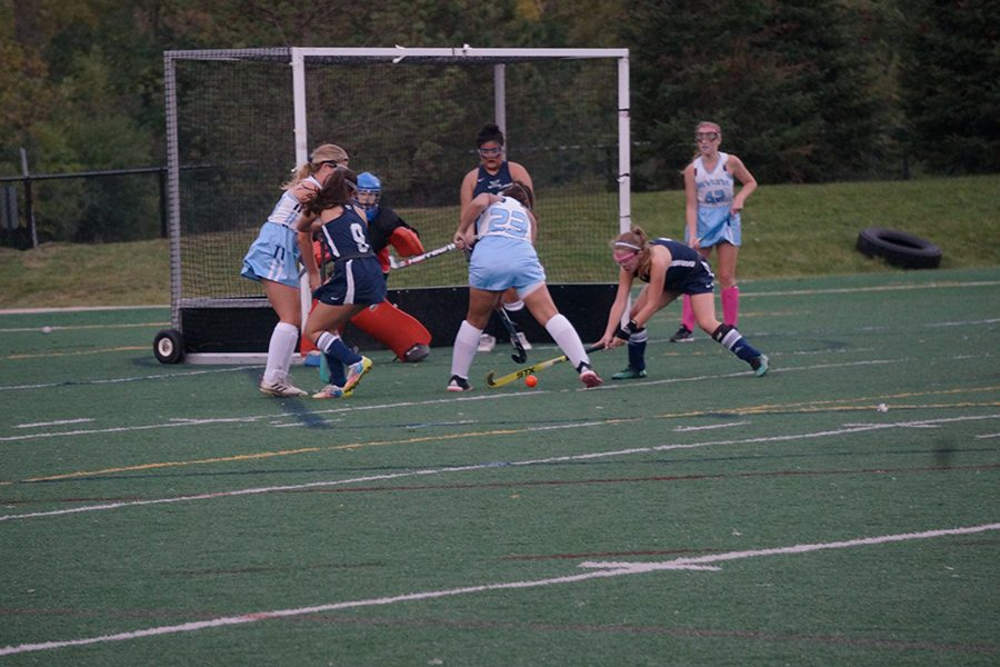 Sophomore Danielle Davis makes a shot on goal while Cranbrook's defense attempts to stop the ball.