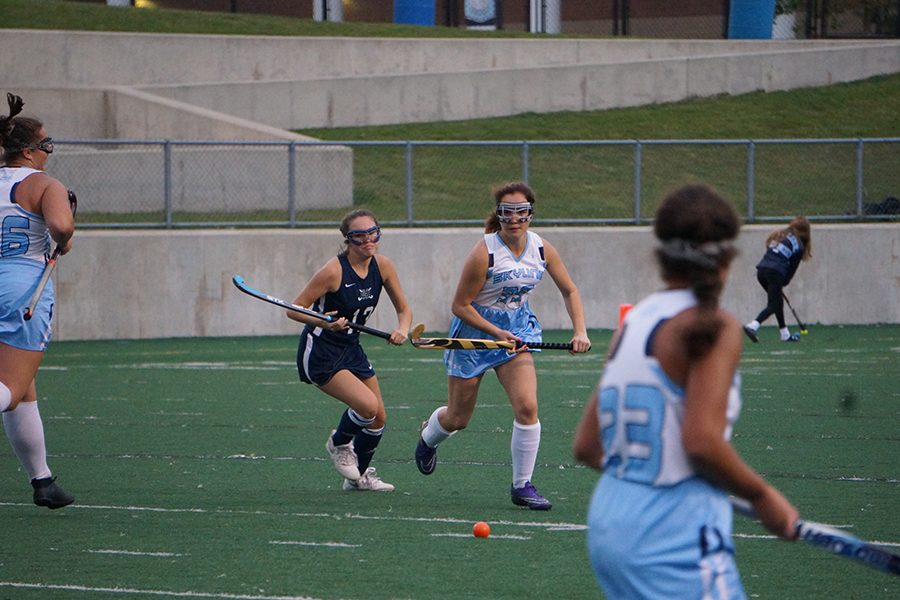 Freshman Kallie Milkie runs towards the ball as other Skyline players move to be open for a pass.