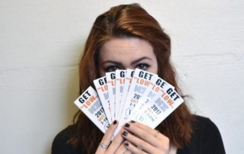 Angelina Smith is a curator of Get LOW. Here she is pictured with a few of the tickets she is selling. There were only 150 tickets produced for the event.