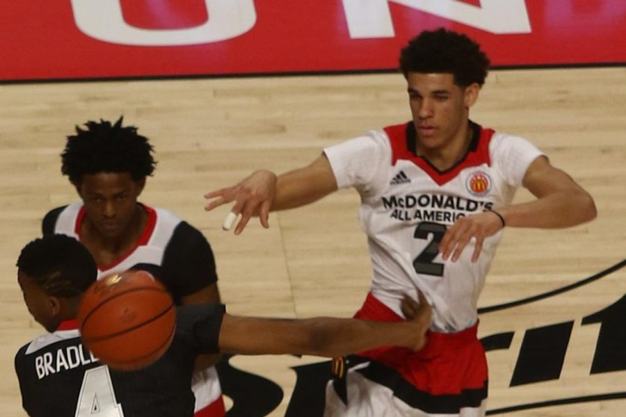 Lonzo+Ball%28white+jersey%29+and+De%27Aaron+Fox%28top+black+jersey%29+playing+during+the+2016+McDonald%27s+All-American+game.