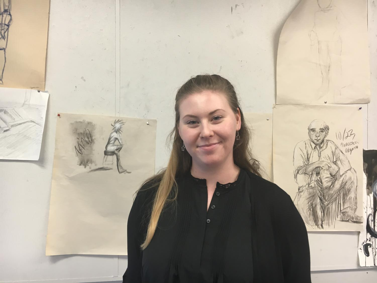 Cassidy Moravy-Penchansky stands infront of students art work. She recently became a student teacher at CHS and was an art director at Camp Al-gon-quain.