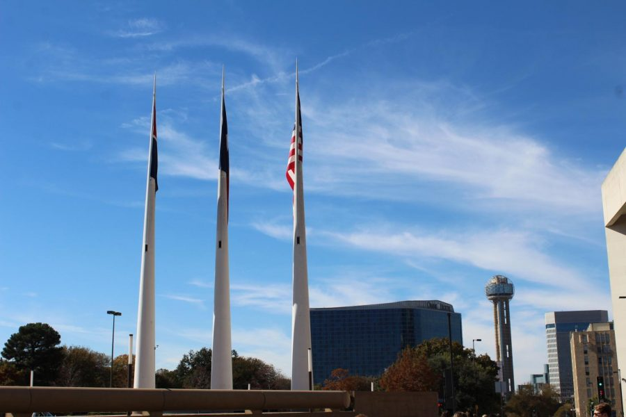 Monument outside the Dallas police station. In the distance is the Hyatt Regency hotel.