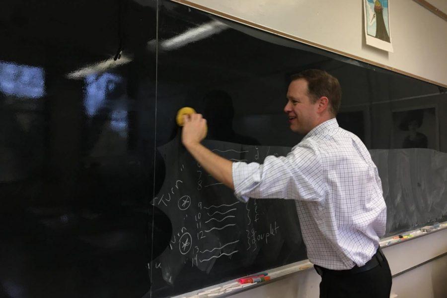 Ken+McGraw+cleans+his+blackboard.