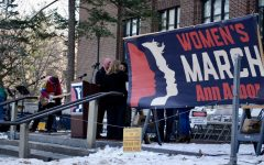 The stage at the Ann Arbor 2018 Women's March.  The march marked the anniversary of the original Women's March, which was held across the nation to protest Donald Trump's presidency and to push for equality. These pictures show people, signs, and moments from the rally.
