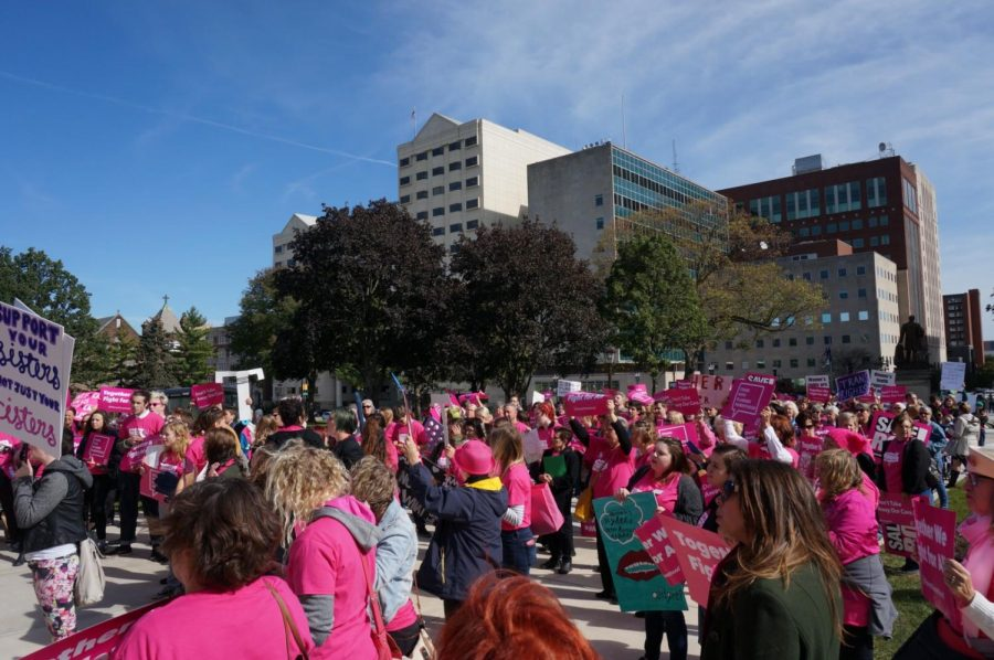 Hundreds+of+women+and+men+march+at+the+Day+For+Action+in+Lansing%2C+Michigan.+The+men+and+women+celebrate+coming+together+after+Rebecca+Warren+gives+a+speech.