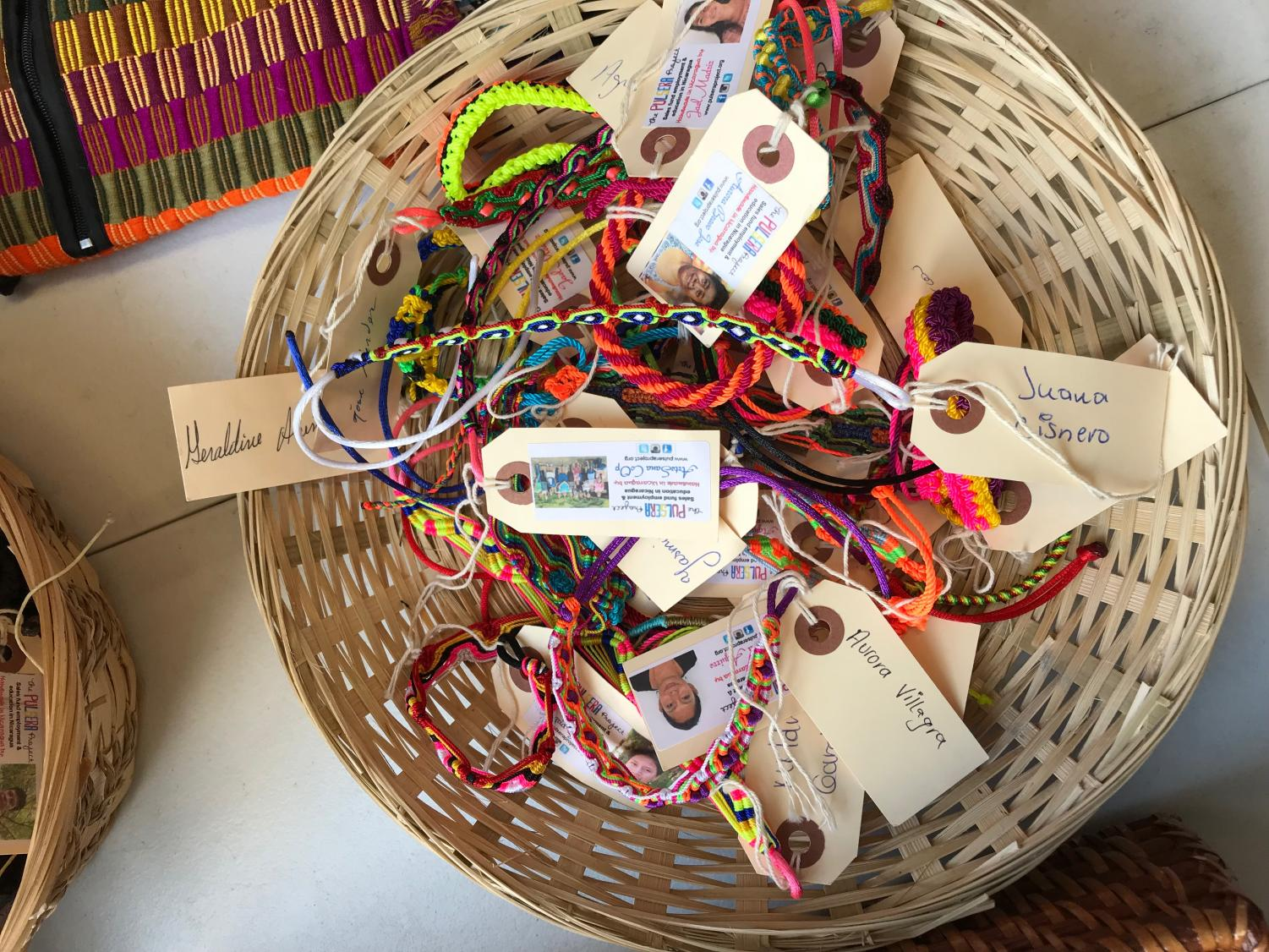 Bracelets sit in a basket on the third floor as high school students proudly sell them.