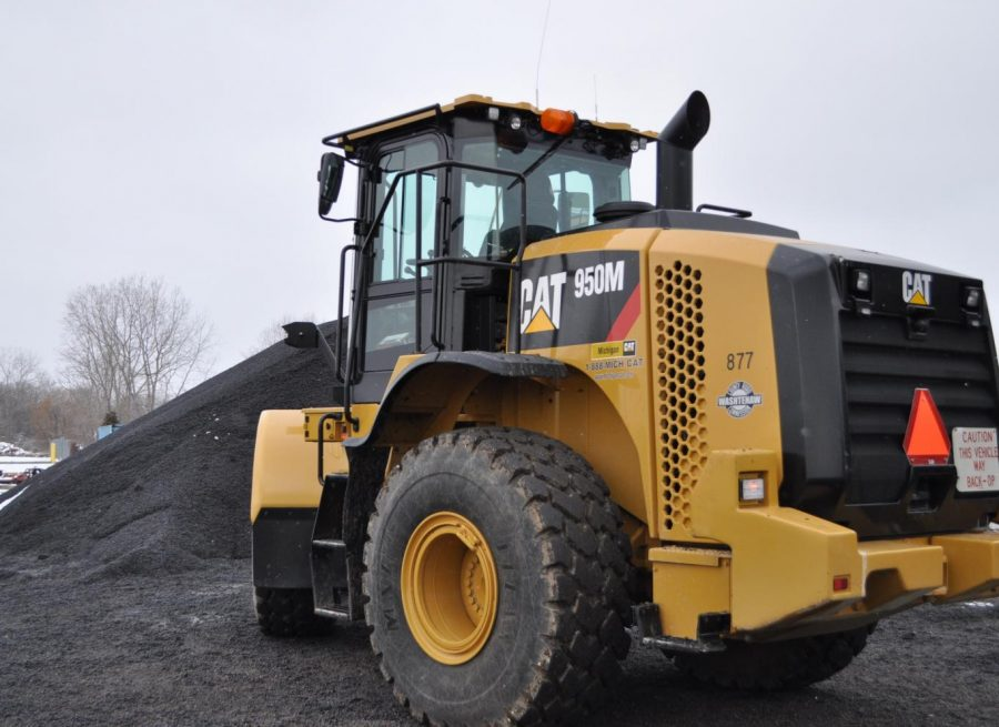 A asphalt truck loads cold patch in the Washtenaw County Road Commission backyards.