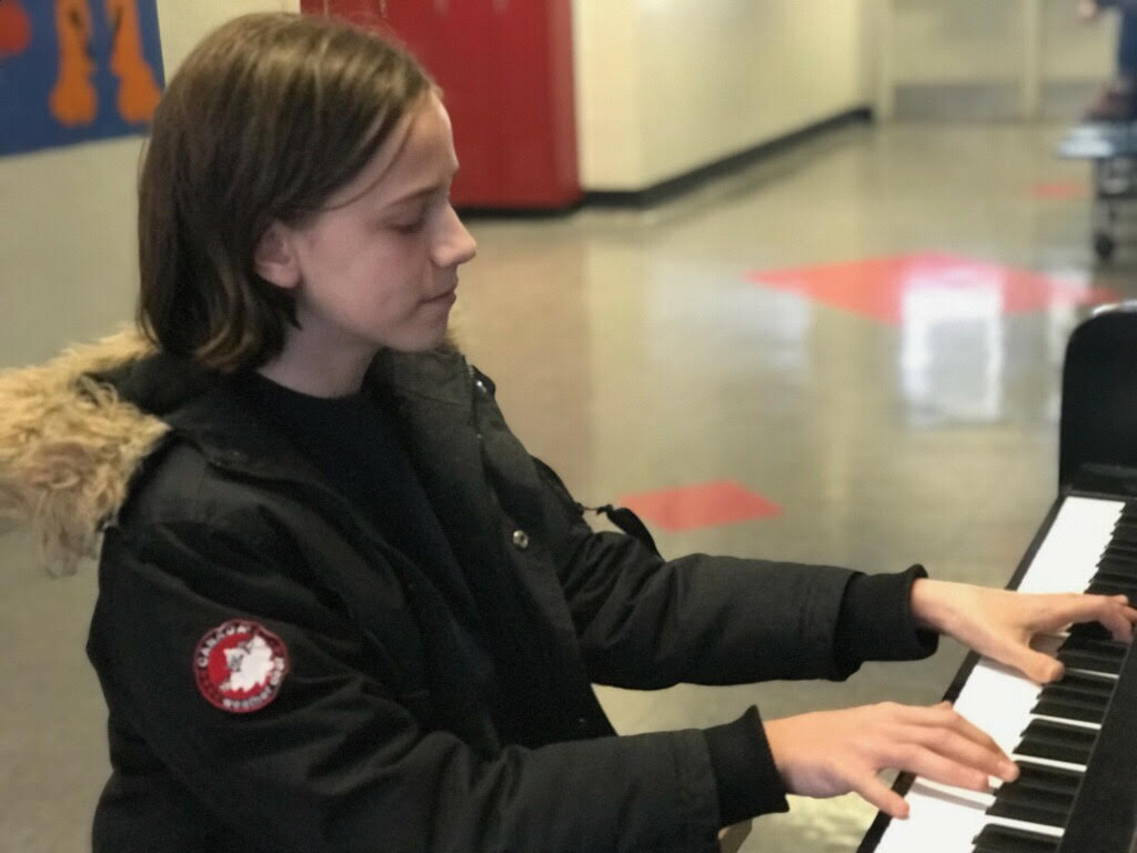 Durr sits at the piano on the third floor of Community High School, performing for students that walk by.   One of Durr's current goals is to play Rachmaninov's second piano concerto with a full orchestra.