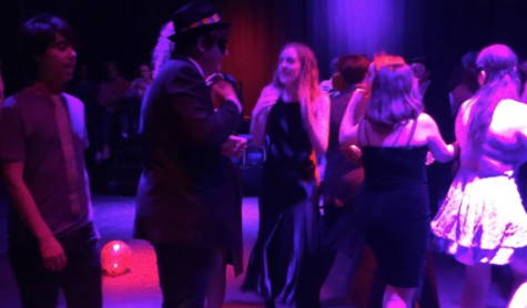 Pictured: Well dressed students dance in Community High