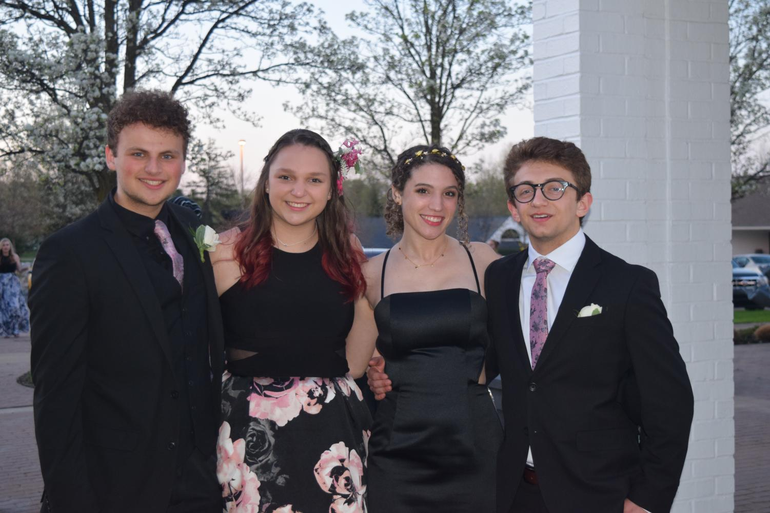 Aris+Chalin%2C+Isabel+Espinosa%2C+Andrea+Schnell+and+Jonah+Eichner+pose+before+entering+prom%2C+held+at+Washtenaw+Golf+Club.+