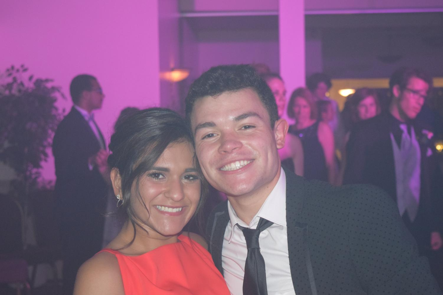 Suephie+Saam+and+her+date%2C+Jordan+Tirico%2C+pose+for+a+picture+on+the+dance+floor.+