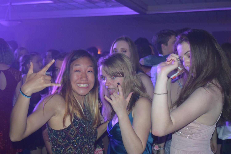 Gina+Liu%2C+Ellie+Vandermark%2C+and+Eleni+Tsadis+dance+at+the+2018+Community+High+Prom.
