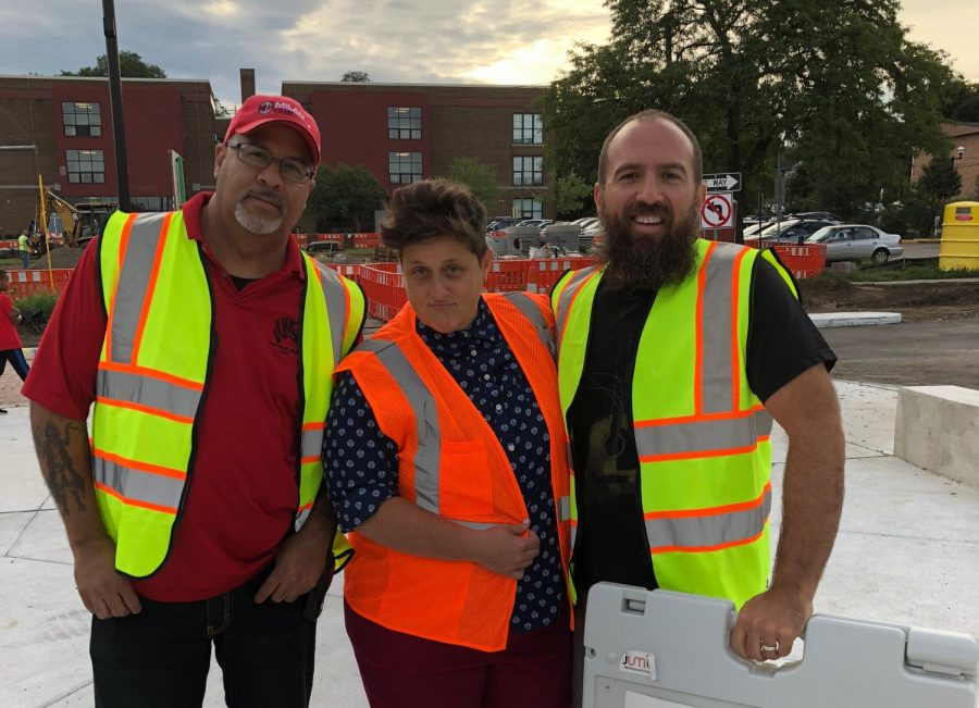 Kevin Davis, Amy McLoughlin, and Brian Williams (left to right) help students cross the street before school