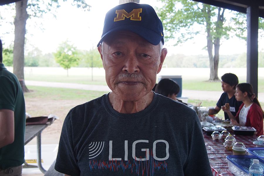 Dr.+Tomozawa%2C+nearly+90+years+old%2C+remains+an+ever+active+member+of+the+physics+community.+He+proudly+wore+his+t-shirt+of+LIGO%2C+the+observatory+that+confirmed+the+existence+of+gravitational+waves.+