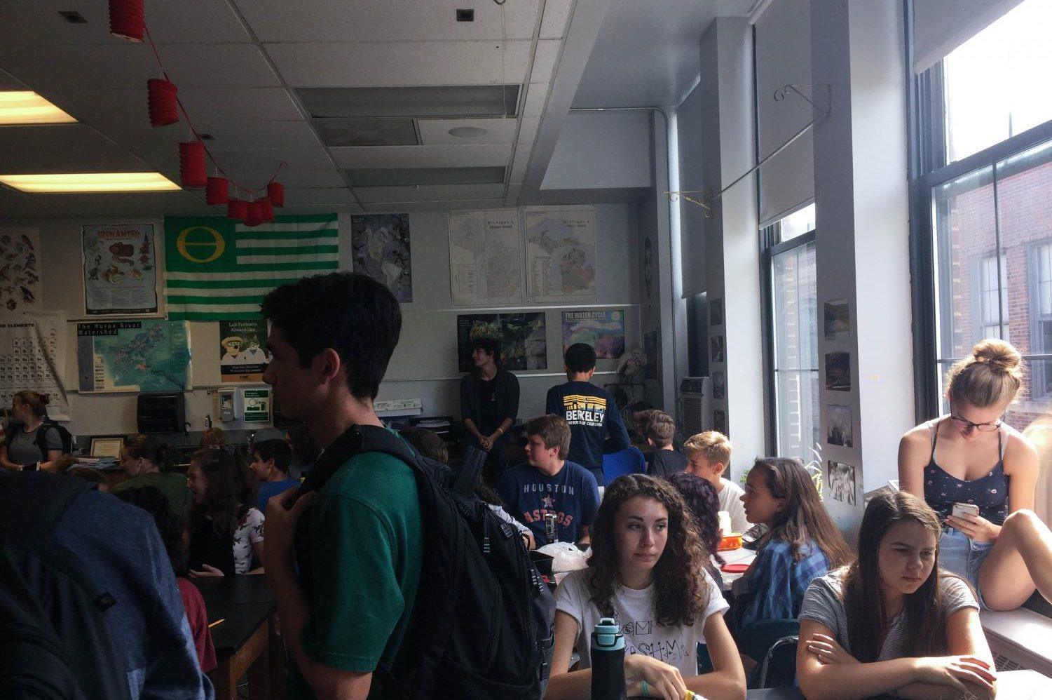 Students sit on counters, windowsills and at crowded tables during the year's first meeting of Ecology Club.