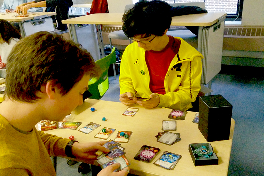 Nato is playing KeyForge in Robert's room on Nov 19. Since this is the first day he (or anyone for that matter) played, he used dice as counters, instead of the fancy pieces.