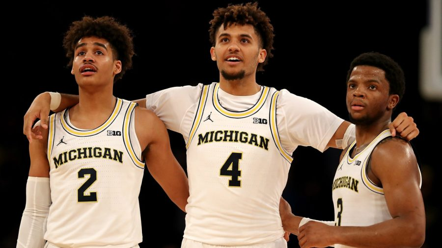 Jordan+Poole+%28left%29%2C+Isaiah+livers+%28middle%29+and+Zavier+Simpson%2C+together+during+the+Big+Ten+tournament+of+the+2018-19+season.