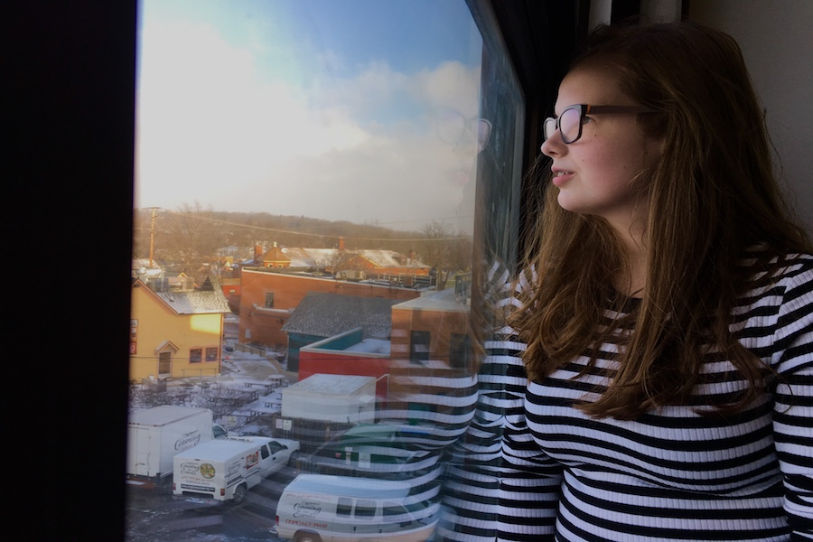 """Martha Ribant stares out the third-floor window of Community High School at the city down below. Ribant was diagnosed in 2017 and, for her, it was a life-changing experience. """"Liberation is the word I would use to describe it,"""" Ribant said."""