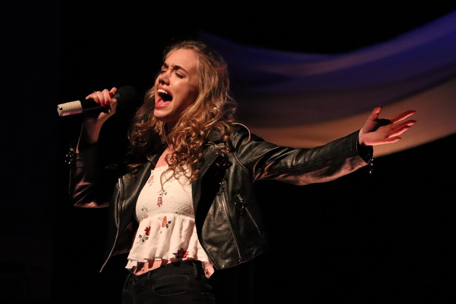 ECA Junior Greer Taylor performing with Seth Dyer during the final performances of the night. The duet earned Tayler and Dyer a standing ovation and landed them in the top 5.