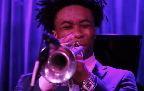 Senior trumpet player Corey Watkins on the trumpet for Sonic Tonic.