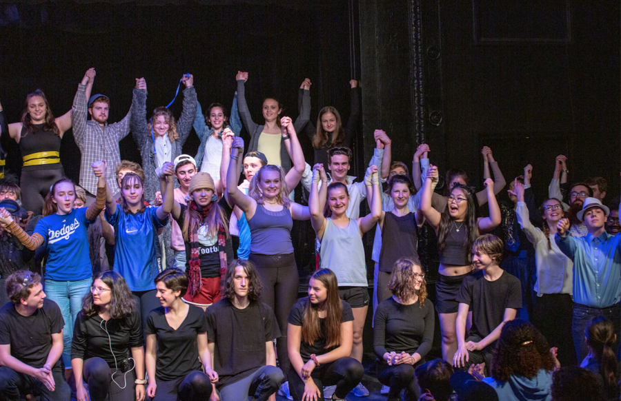 CET staff and students hold hands at the end of their final curtain call.