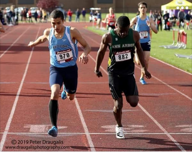 Savante Daniel(left) running the 400-meter-dash at the conference championship.